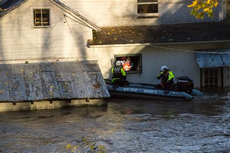 One person dead after being swept away in flood waters in